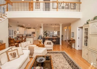 Cozy living room, catwalk, and kitchen