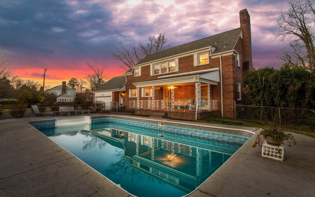 Photo of brick house highlighting the pool